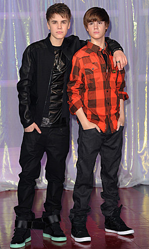 Justin Bieber gets a waxwork while Selena Gomez appears on TV