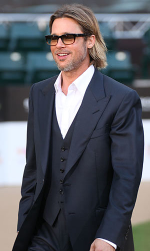 Brad Pitt gets suited and booted for the US premiere of Moneyball