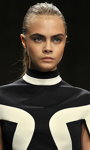 Cara Delevingne reveals the secret to her catwalk-worthy cheekbones