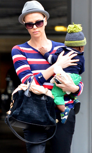 CELEBRITY HAIR: Charlize Theron gets her hair shaved off!
