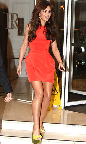 Cheryl Cole admits she's got braver with style as she hits Paris in a tangerine dress!