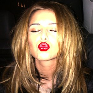 Cheryl Cole shows off her L'Oreal lipstick!