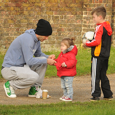 David Beckham and his boys take Harper for a kick about