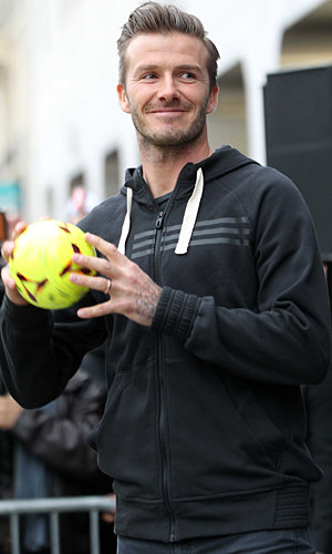 David Beckham wows the crowds in Paris with Adidas store appearance