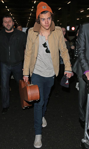 Harry Styles jets home after island holiday