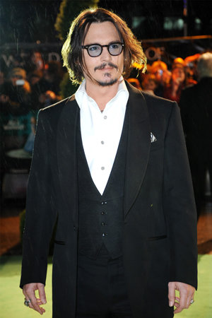 Johnny Depp and Anne Hathaway hit the royal premiere of Alice in Wonderland