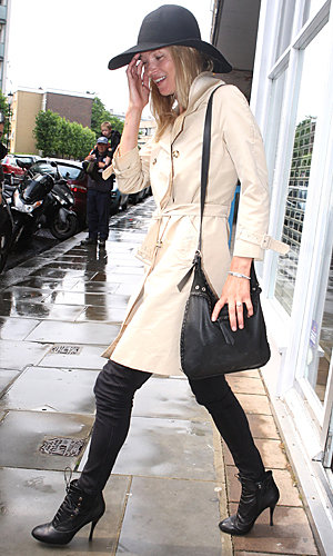 Kate Moss models a mac to manage the rain
