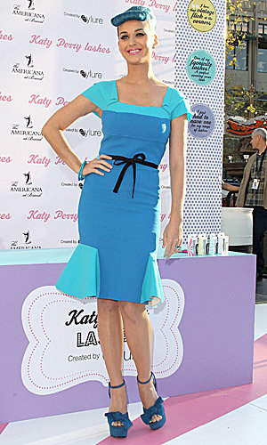 Katy Perry makes a splash in blue as she unveils new beauty venture