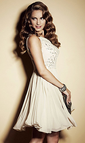 WOW! Kelly Brook sizzles as she models party dresses for New Look