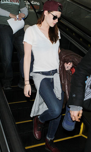 Kristen Stewart wears Robert Pattinson's jacket as she flies to LA