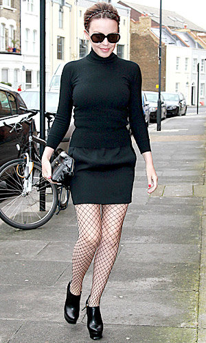 CELEB TREND: Kylie struts out in fishnets!