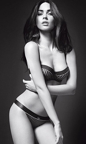 Megan Fox sizzles as she strips for new Armani underwear ad