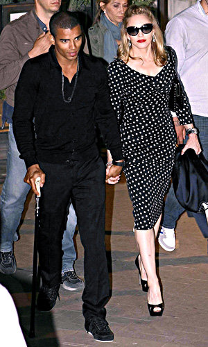 Madonna shows off her new man on her latest world tour!