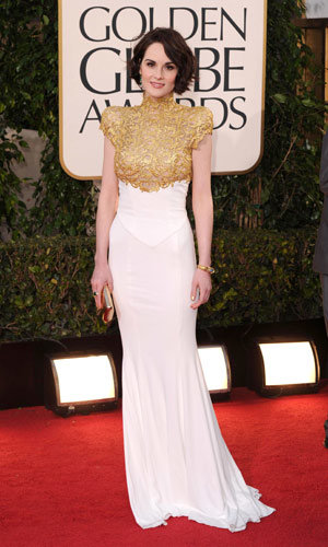 Michelle Dockery and Kelly Osbourne arrive at the Golden Globe Awards 2013