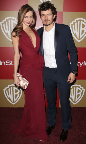 Miranda Kerr and Orlando Bloom are loved up at InStyle's Golden Globes party