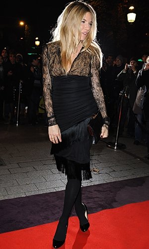 Sienna Miller works a lacey LBD on the red carpet