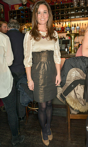 Pippa Middleton gets in the party mood in metallics