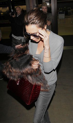 PICS: Cheryl Cole and Victoria Beckham's airport chic