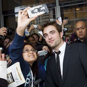 WATCH: Robert Pattinson hangs out with fans at the Cosmopolis screening!