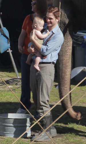 SEE PICS! Robert Pattinson holding a baby on set of Water For Elephants
