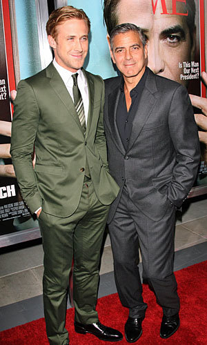 WOW! Ryan Gosling and George Clooney hug it out at The Ides of March premiere