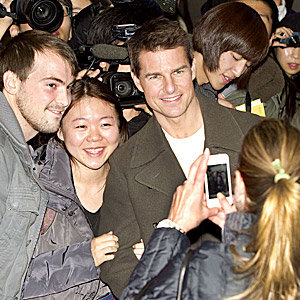 SEE PICS! Tom Cruise mobbed by fans in at Mission Impossible bash