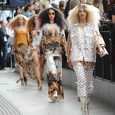 We've got the backstage scoop from Topshop Unique's disco-glam SS11 show!