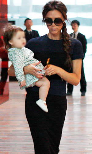 Victoria Beckham out with Harper in Beijing!