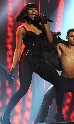 Alexandra Burke wows crowds in a sexy studded leotard for T4 performance