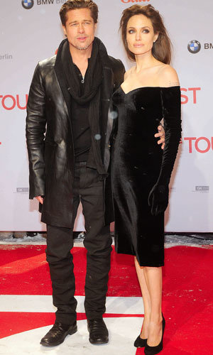 WOW! Angelina Jolie has Brad Pitt AND Johnny Depp as arm-candy at premiere of The Tourist