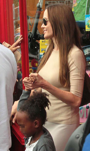 Angelina Jolie goes toy shopping with Zahara and Shiloh in Richmond!