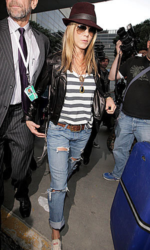 Stars' airport chic: Jennifer Aniston, David Beckham and Rihanna keep their cool at LAX
