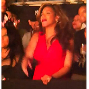 Pregnant Beyonce shows off baby bump at Jay-Z concert!