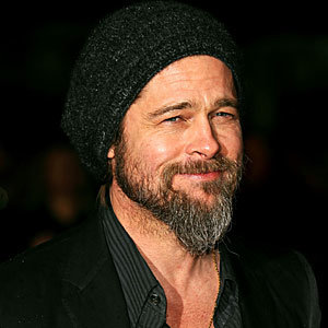 PICS: Brad Pitt shaves off beard - and looks as hunky as ever!