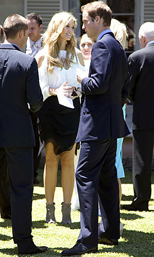 G'day! Prince William bumps into Delta Goodrem on trip to Australia