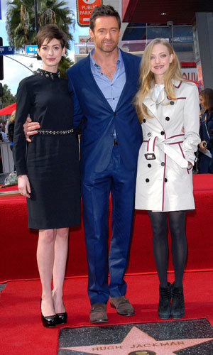 Anne Hathaway and Amanda Seyfried cheer on Hugh Jackman at Hollywood ceremony