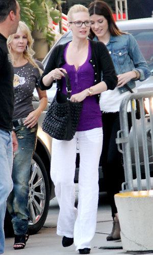 PREGNANT CELEBS: January Jones shows off her baby bump at LA Lakers game