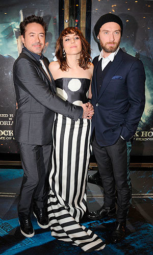 Jude Law and Robert Downey Jr are all smiles at the Sherlock Holmes 2 premiere!