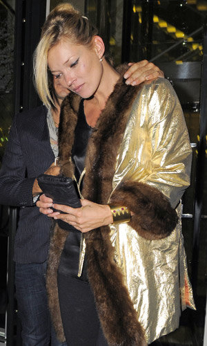 Kate Moss glams up in gold
