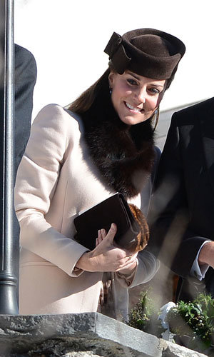 Kate Middleton shows off pregnancy wedding guest style