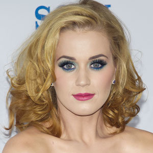 Katy Perry shows off new blonde locks at The Smurfs premiere