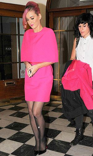 PINK POWER: Katy Perry matches bubblegum beehive to fluro fuchsia frock for a London night out…