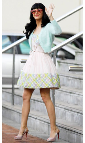 Katy Perry goes doll-chic as she hits Manchester
