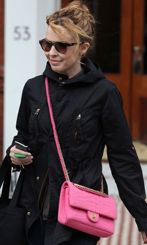PICS: Kylie Minogue works the satchel trend while out with Andres Velencoso