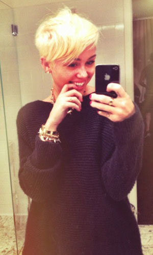 Miley Cyrus reveals dramatic blonde cropped hair on Twitter