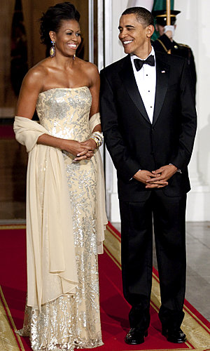 Michelle Obama glitters in gold at state dinner