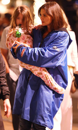 Katie Holmes gives Suri a tour of her new film set