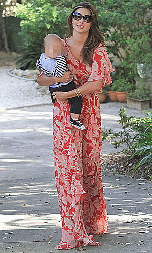 Miranda Kerr works stunning maxi dress on outing with baby Flynn