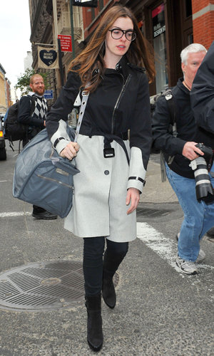 SPOTTED: Anne Hathaway goes geek chic in New York!