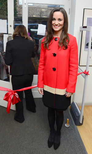 Pippa Middleton recycles her favourite festive red coat for charity appearance